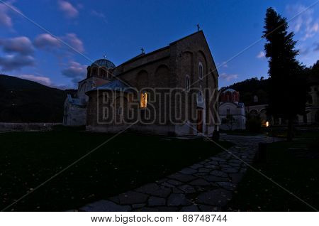 Two churches inside Studenica monastery during evening prayer