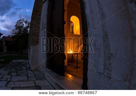 Entrance to church inside Studenica monastery at evening