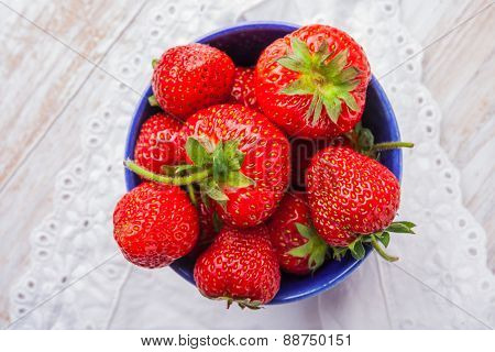 Fresh Strawberries In A Small Blue Bowl