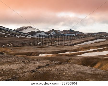 Rainbow mountains with fields of snow