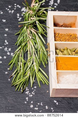 Wooden Box Of Spices And Fresh Rosemary