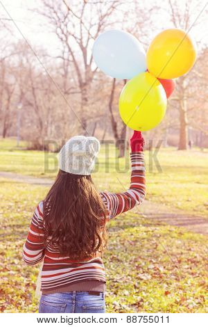 Female Holding Colorful Balloons Outdoor