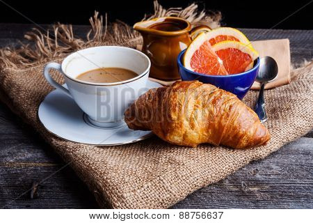 Cup Of Coffee With Milk, Grapefruit And Fresh Croissant