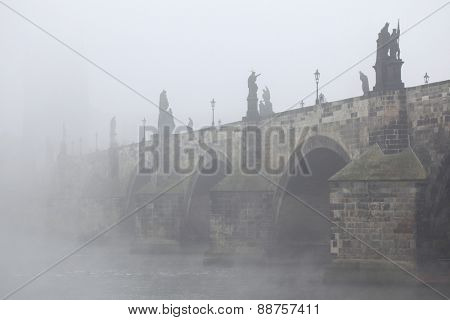 Morning fog over the Charles Bridge in Prague, Czech Republic.