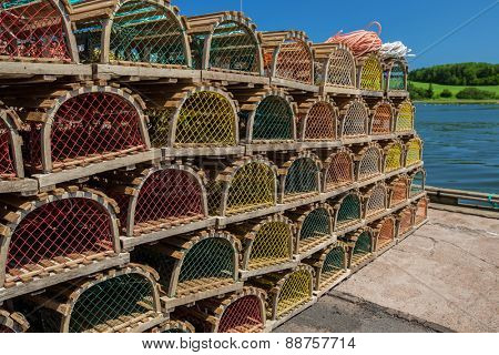 Stack of lobster traps on a wharf in rural Prince Edward Island, Canada.