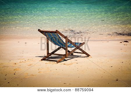 Exotic beach holiday background with beach chair