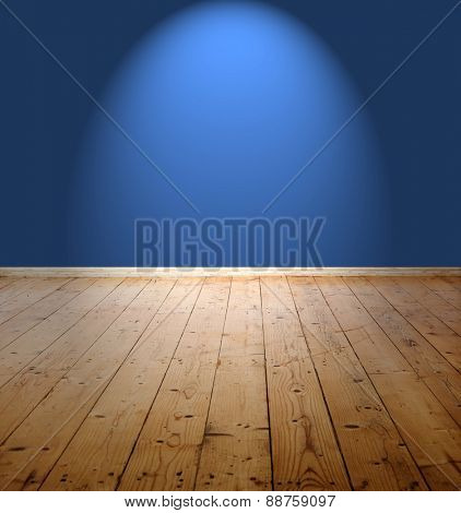 Empty room with blue wall and wooden floor