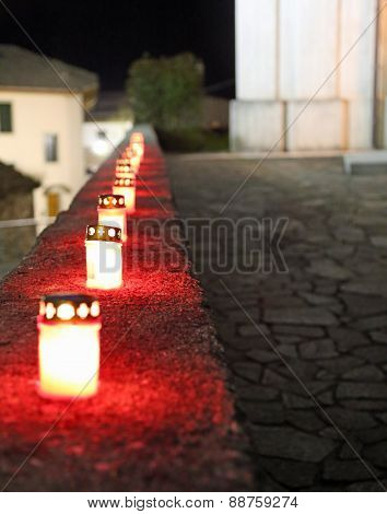 Red Candles In The Churchyard During Mass Outdoors At Night