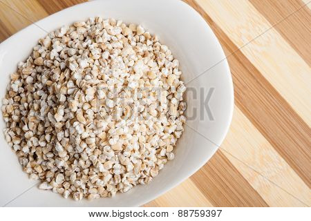 Barley Groats In White Bowl
