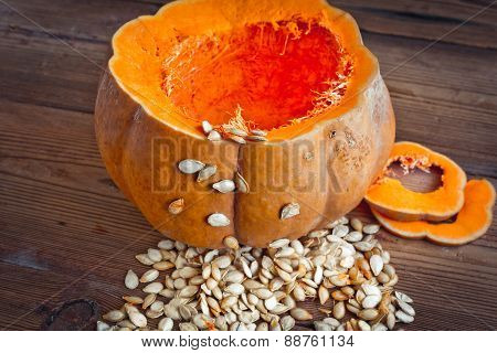 pumpkin and seeds on wood background