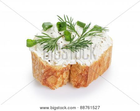 crunchy baguette slice with cream cheese and herbs isolated