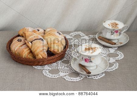 Croissants and coffee on the table