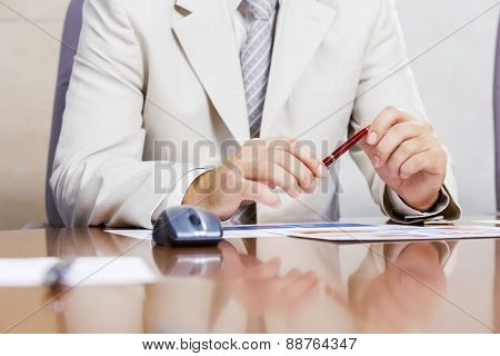 Businessman sitting at table and working in the office