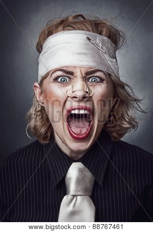 Furious Face Of Injured Woman With Bandage On Head Screaming.