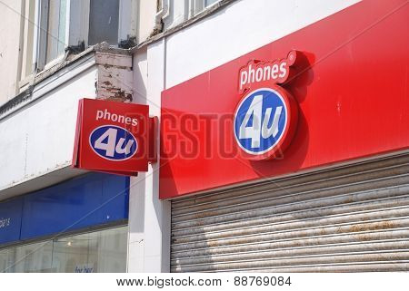 HASTINGS, ENGLAND - APRIL 22, 2015: The exterior of a Phones 4U mobile phone store. Founded in 1987, all 720 UK outlets closed down in September 2014 after the company went into administration.