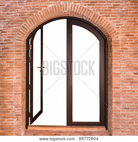 Black Arch Door On Red Brick Wall