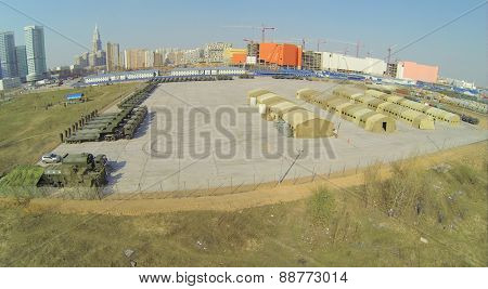 MOSCOW, RUSSIA - APRIL 19, 2014: Base with tents and military equipment prepared for Victory Day Parade at spring sunny day, aerial view