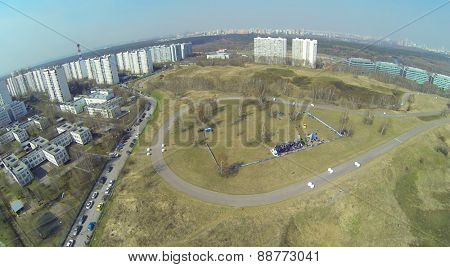MOSCOW, RUSSIA - APRIL 19, 2014: Cityscape with race track in Krylatskoe district during Rally Masters Show at sunny spring day, aerial view