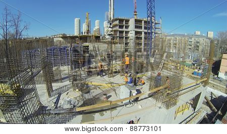 MOSCOW, RUSSIA - APRIL 8, 2014: Builders work at construction site of residential complex Falcon Fort at sunny spring day, aerial view