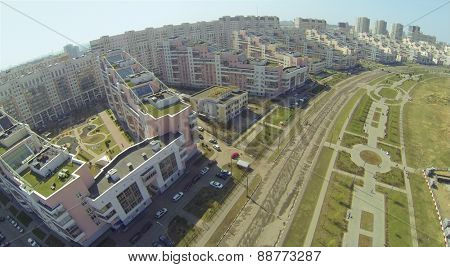 MOSCOW, RUSSIA - APRIL 20, 2014: Residential buildings near alley of Pilots Heroes at Hodynskoe field at spring sunny day, aerial view