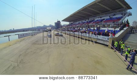 MOSCOW, RUSSIA - APRIL 19, 2014: Tribunes with the people watching the Rally Masters Show on the shore of the Grebnoy canal, aerial view