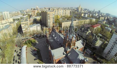 MOSCOW, RUSSIA - APRIL 20, 2014: Cityscape with catholic cathedral of Immaculate Conception of Blessed Virgin Mary, aerial view. Cathedral was opened in 1911