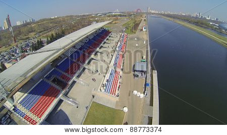 MOSCOW, RUSSIA - APRIL 19, 2014: The track and tribunes on the shore on the Grebnoy canal during the Rally Masters Show, aerial view