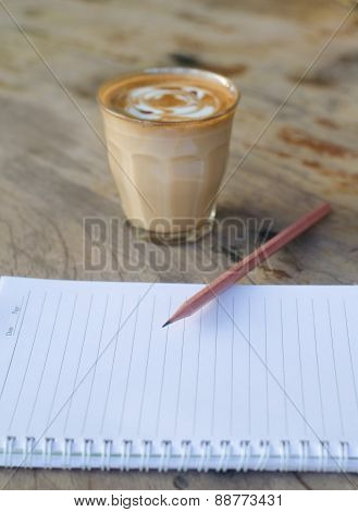 Whit Paper And Hot Coffee On Wooden Table
