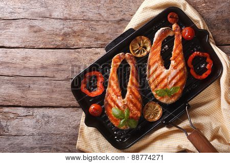 Salmon Steak With Vegetables On A Grill Pan. Horizontal Top View