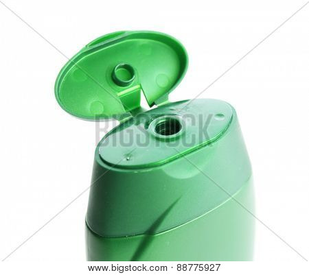 Open cosmetic bottle isolated on white