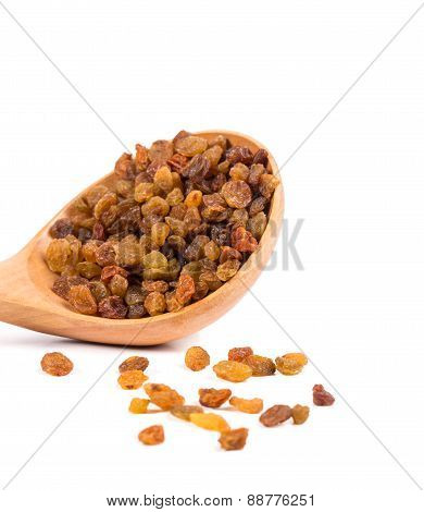 Wooden spoon with raisins