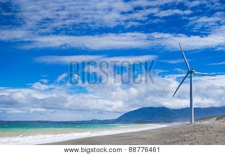 Windmills Power Generators At Ocean Coastline. Philippines