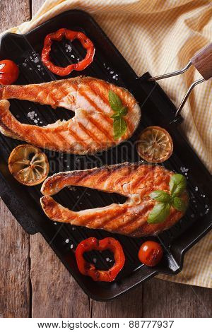 Salmon Steaks And Vegetables On Grill Closeup. Vertical Top View