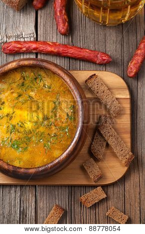Traditional bavarian beer soup with sausage croutons parsley and