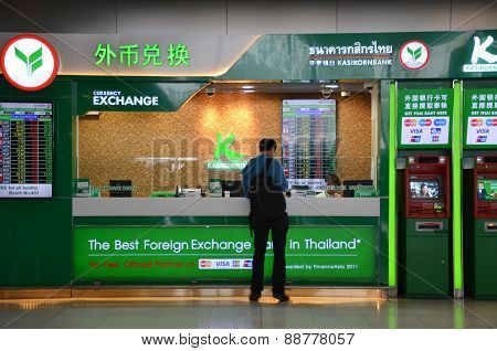 Unidentified Tourist Exchanges Money In Bangkok Airport, Thailand