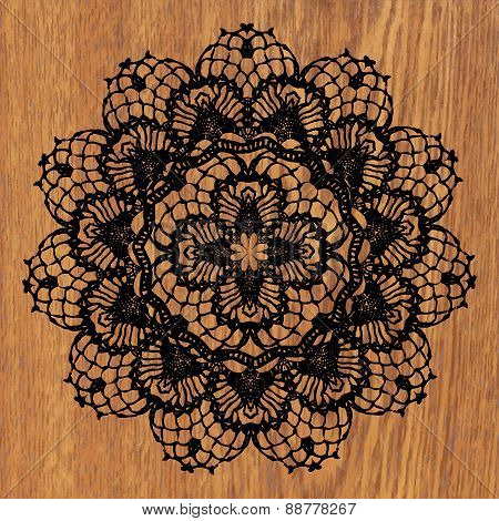 Black crochet doily.
