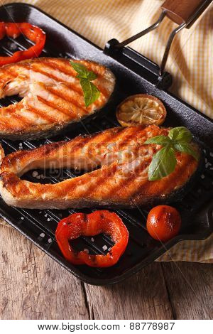 Two Salmon Steak And Vegetables On The Grill, Vertical