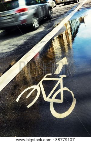 Sign Of The Water Cycle Paths On The Street In The Reflection Of The City