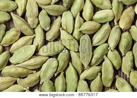 Cardamom green super food asian spice close up background texture