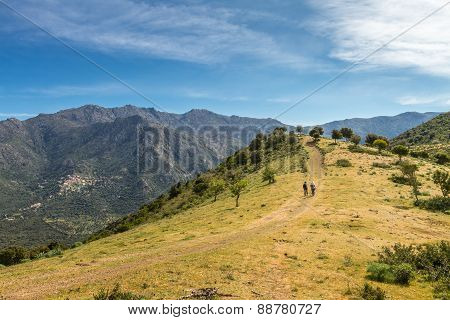 Two Hikers On Trail Near Novella In Balagne Region Of Corsica