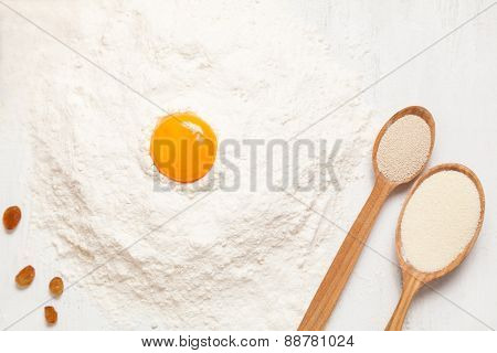Pastry ingredients. Egg, flour and yeast on white rustic table