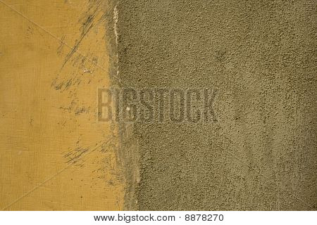 Grunge Yellow Painted Wall With Cement Area