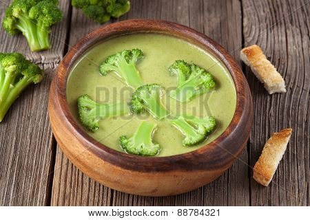 Heathy cream of broccoli green delicious soup with croutons