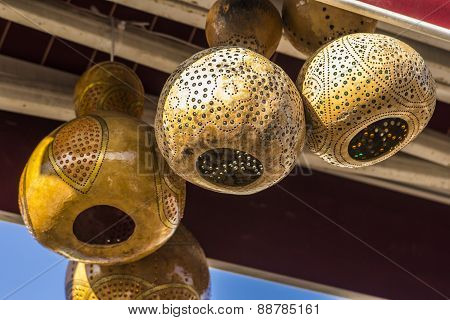 patterned decorative lamps made of dried pumpkins in a cafe