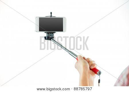 Casual brunette taking a selfie shot in studio