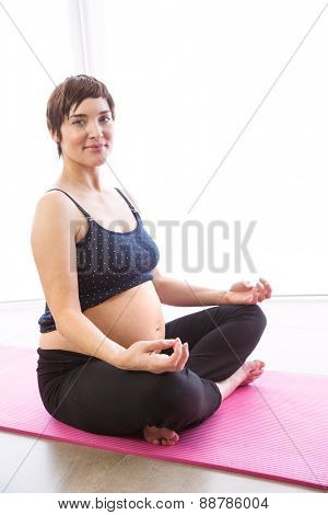 Pregnant woman keeping in shape at home