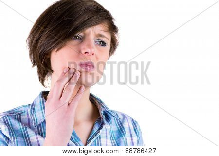 Pretty brunette with a toothache on white background
