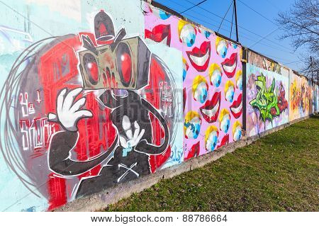 Colorful Graffiti With Cartoon Character Over Old Gray Concrete Wall