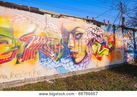 Colorful Graffiti With Girl Portrait Over Old Gray Concrete Garage Walls