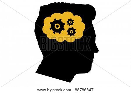 Cogs and wheels in cloud against silhouette of head